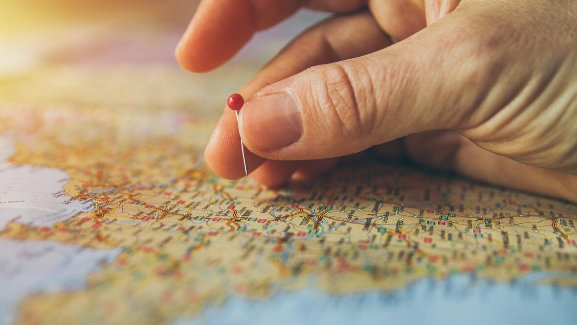 canva-hand-pinning-country-in-a-map